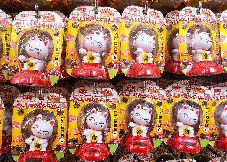 6. The Solar-Powered White Lucky Cat -- Be Soothed By Its Charming Gesture!