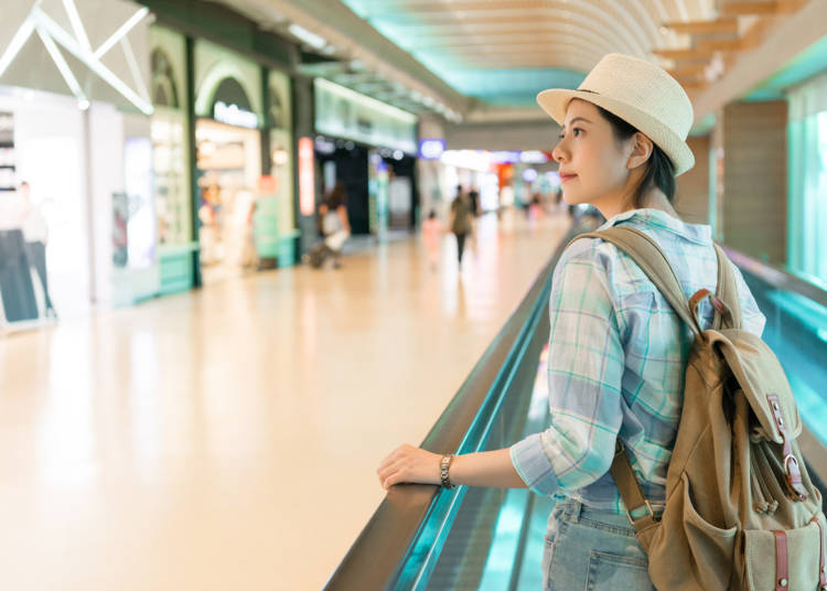 What kind of duty-free shops are in each terminal and where are they located?