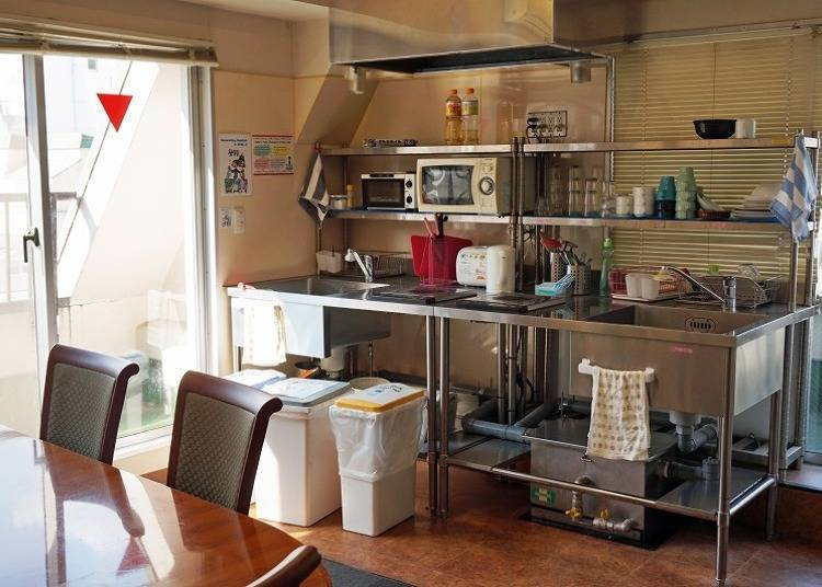 A shared kitchen and coin laundry, making things a little easier for those staying long term