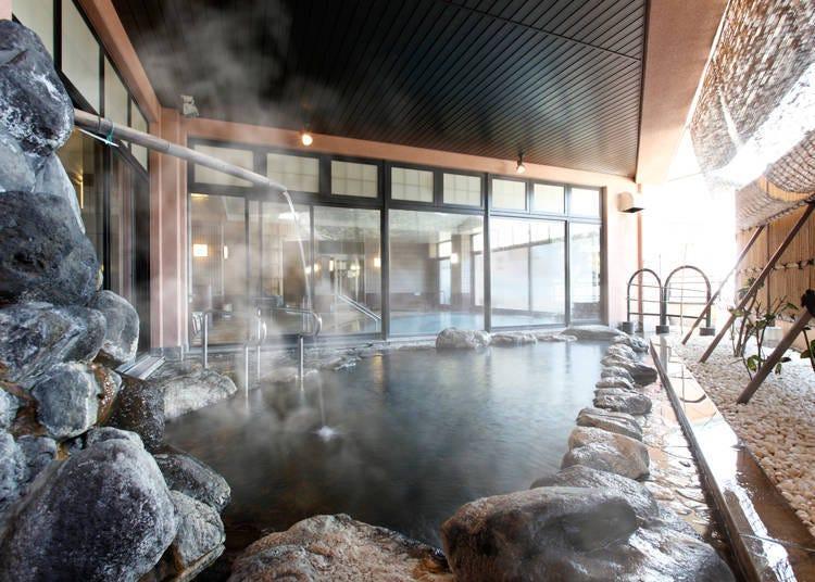 4. Heartpia Atami: Natural hot spring with lie-down baths and cascading baths