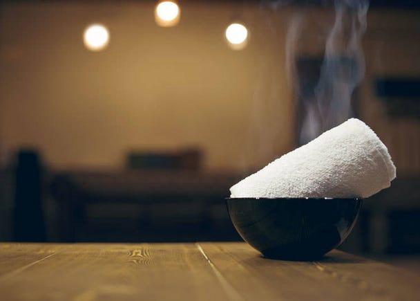 Steamed onsen towels, a gensen kakenagashi (free-flowing natural spring water) specialty