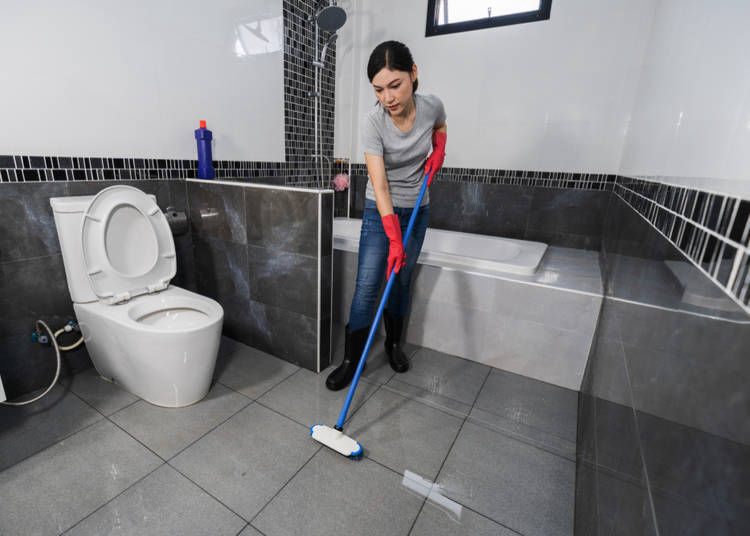 6. Cleaning Staff in the Bathroom