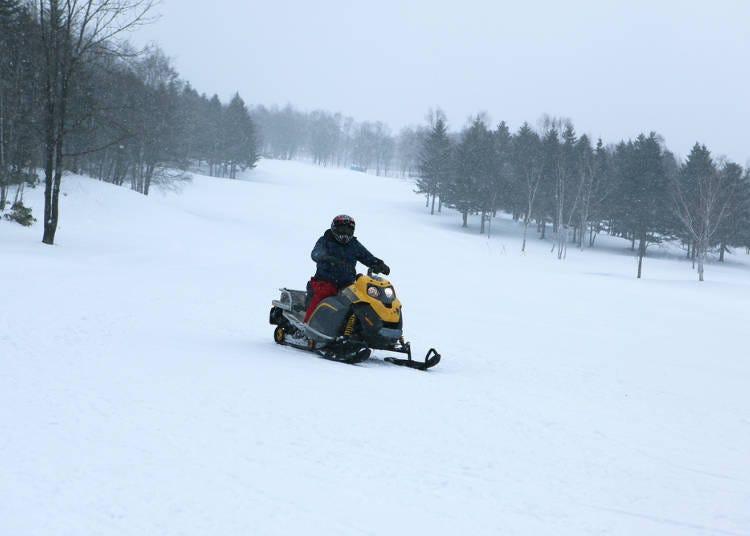 4. Snowmobiling: Sprint through the snow fields on a snowmobile or a snow raft!