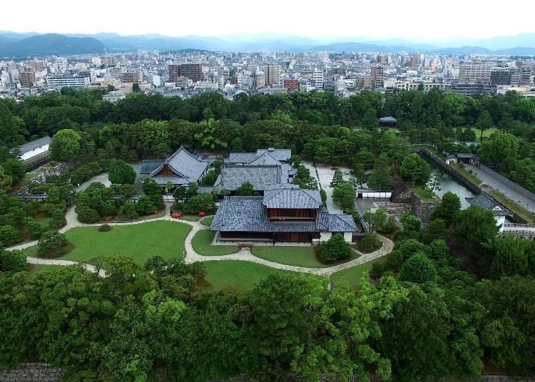 Beautiful green grass and a paved path: Honmaru Garden