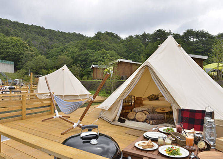 Relax in luxurious tents with comfy beds and sofas