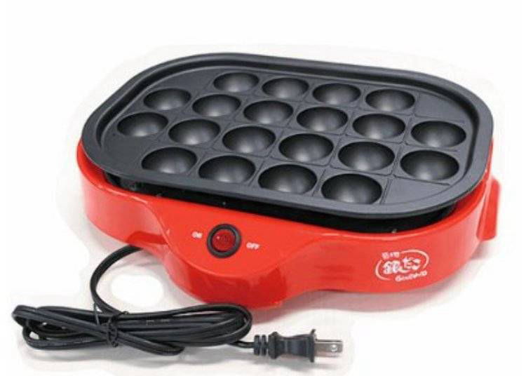5. Takoyaki cooker with guiding grooves