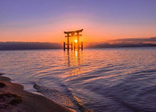 3) Shirahige Shrine (Shiga): A fantasy-like view of temple gates floating on the waters of Lake Biwa