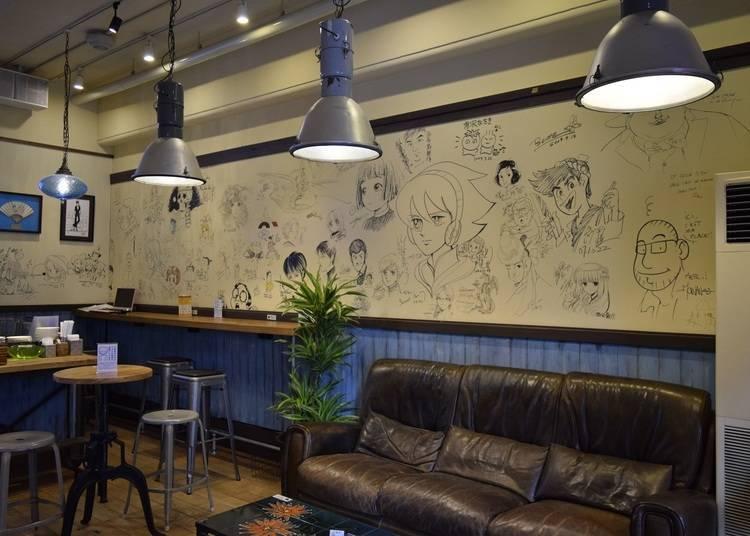 牆上貼滿漫畫家親筆簽名的博物館咖啡廳