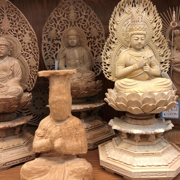 Hand-craved Buddha statues by artisans.