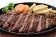 ジュージュー鉄板焼ステーキ(サーロインステーキ1,155円)