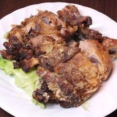 鶏モモ骨付き唐げ黒胡椒炒め