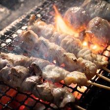 豪快に炭火で焼き上げる串焼き