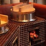 薪をくべて炊き上げる ごはんは最高の美味。