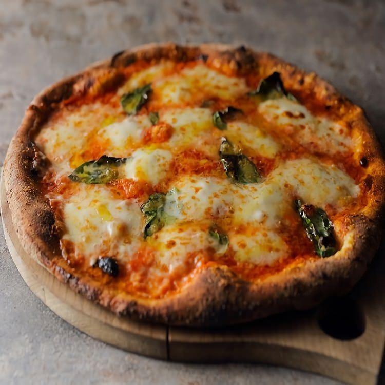 専用釜で焼き上げるピッツァ