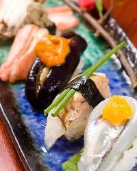 熟練の技が織りなすお寿司
