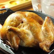 【名物 丸鶏一羽鉄炭焼】 3~4名様でどうぞ。