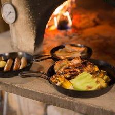 自慢の石窯で焼き上げた自家製料理