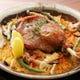 鴨コンフィのパエリア 低温調理された鴨肉はほろほろと柔らか