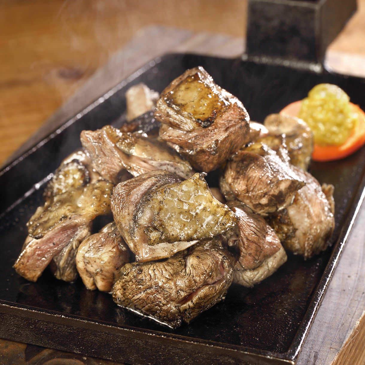 塚田農場の看板料理「地鶏炭火焼」