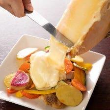 季節野菜と地鶏のラクレットチーズかけ