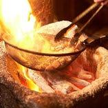 地鶏を炭火で豪快に焼き上げます!