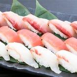 〆の一品はお寿司。盛り合わせでお持ちいたします、冬の鮮魚をお楽しみください。