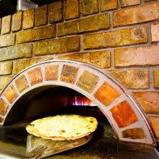 自慢の窯焼きピザ