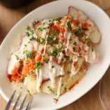 「タコと青唐辛子のポテサラ」肉厚でうまみたっぷりのタコとピリっと程よい辛みの効いたポテトサラダは、お酒のおつまみに最適!