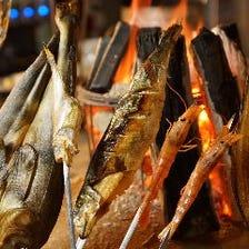その日の旬な海産物の原始焼き