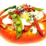 若鶏もも肉とイタリア産モッツァレラチーズのピッツァイオーラ マルサラ酒のソースで