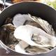 牡蠣の鍋蒸し  名物どんど焼き