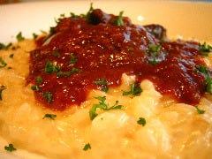 牛ほほ肉赤ワイン煮込みを乗せた    パルメジャーノチーズのリゾット