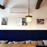 因島出身のコピーライター『村上美佳』さんの作品が店内に飾られています。