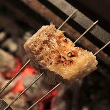 炭火で焼き上げる料理