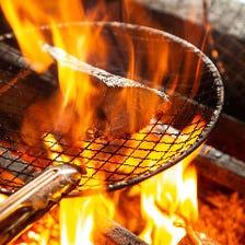 職人技!藁と竹炭2つの炎で豪快に!