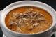 豚骨スープでコトコト煮込んだもつ煮