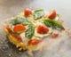 ポチを象徴する開店当初から名物の一品『ピザ玉』
