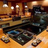 いけすを囲むカウンター26席 堀コタツテーブル5席(1階)