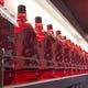 店内は赤白で統一感ある内装です♪ ボトルキープ棚もズラリ!