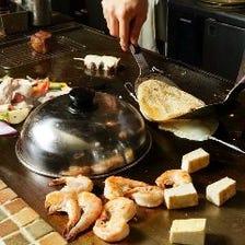目の前で調理を楽しめるカウンター席