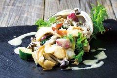 北寄貝と旬野菜の鉄板焼 アンチョビバター風味